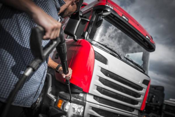 depositphotos_201686820-stock-photo-detailer-truck-washing-using-high